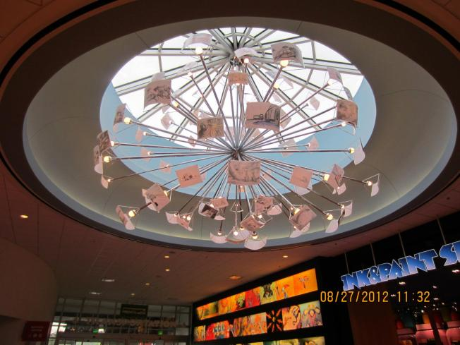 The brilliant chandelier in the main lobby. The light shades are animation sketches.