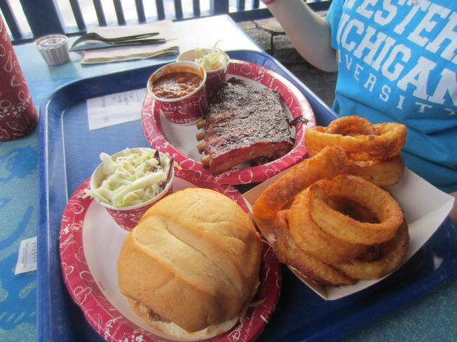 That's a half rack of ribs, baked beans and slaw in front of Ashley. A pulled pork sandwich and slaw to the left and a nice portion of delicious onion rings to the right.