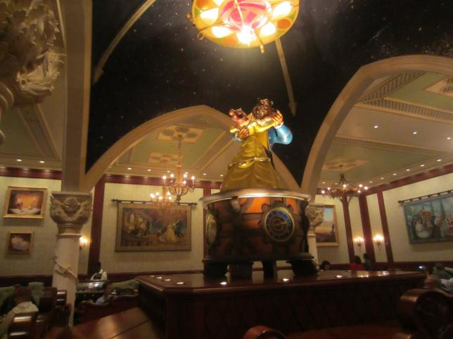 Belle and Beast adorn the center of the room with their beautiful dancing.