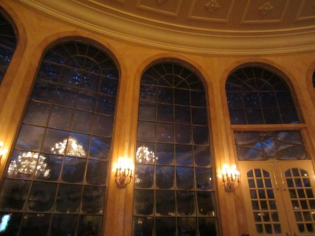 It snows outside the giant windows at the end of the ballroom which is very magical.