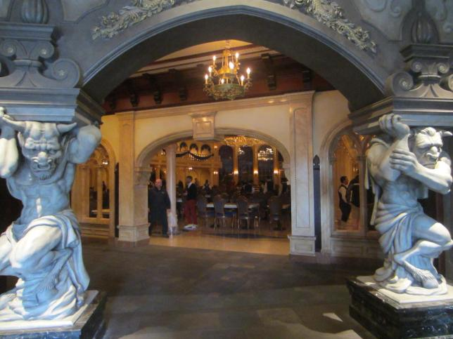 This is your view as you first walk in the doors. To the left is the exit. To the right is the corridor leading to the ordering room. Straight ahead is the ballroom. If you walk past the Minotaurs then turn left you will find the restrooms.