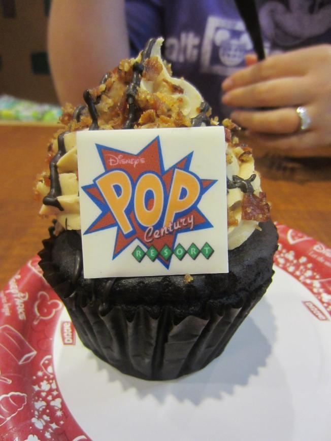 Chocolate cupcake with banana filling, peanut butter frosting and candied bacon bits on top. She liked it but said the candied bacon was strange. I tried some and agree.